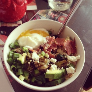 Oats & flax topped w/ veggies, goat cheese, turkey bacon, and a poached egg