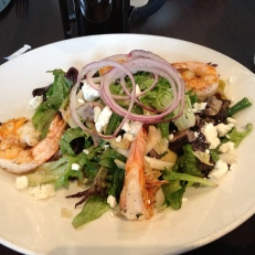 Grilled shrimp over a salad of greens, portabella, hericot verts, red onion, and goat cheese