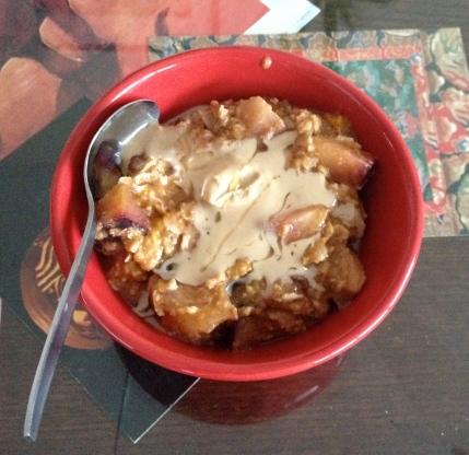 Plum & pumpkin oatmeal topped with tahini & honey