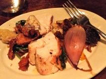 A sampling of (left to right): crispy potatoes, sea bass, chicken with salsa verde, cauliflower, skirt steak with red onion
